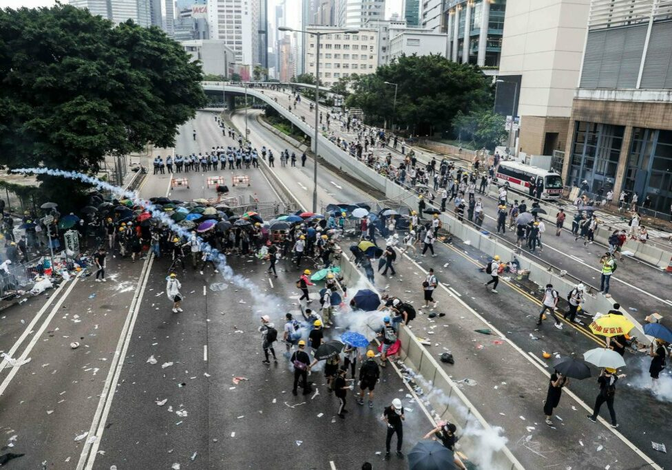 Protesters throw back a tear gas canister fired by police during a rally against a controversial extradition law proposal outside the government headquarters in Hong Kong on June 12, 2019. - Violent clashes broke out in Hong Kong on June 12 as police tried to stop protesters storming the city's parliament, while tens of thousands of people blocked key arteries in a show of strength against government plans to allow extraditions to China. (Photo by DALE DE LA REY / AFP)DALE DE LA REY/AFP/Getty Images